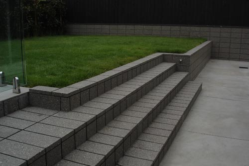 Fire Ash Steps. Anything Is Possible With Honed Masonry. Grey Coloured Capping Blocks Were Used To Make These Steps.
